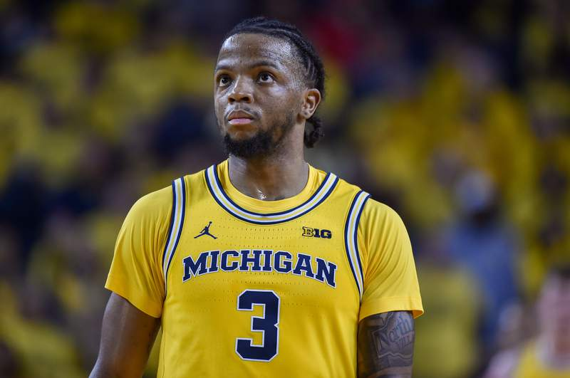 Zavier Simpson #3 of the Michigan Wolverines looks on during the second half of a college basketball game against the Ohio State Buckeyes at Crisler Arena on February 04, 2020 in Ann Arbor, Michigan.