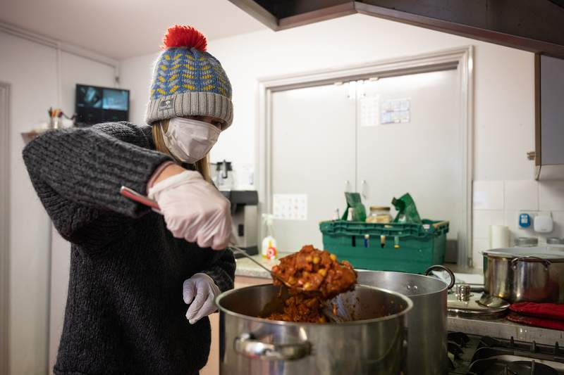 A volunteer from Ealing Soup Kitchen prepares food parcels for clients on March 30, 2020 in Ealing, England. (Photo by Leon Neal/Getty Images)