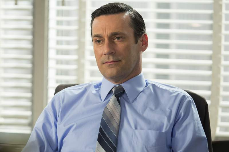"""This image released by AMC shows Jon Hamm as Don Draper in a scene from the final season of """"Mad Men."""" AMC took a chance by debuting a 60s period piece set in a New York ad agency filled with guys who took three-martini lunches and had trysts with secretaries. It was Mad Men and its anti-hero was the manly, forever mysterious Don Draper, played by Jon Hamm.  (Justina Mintz/AMC via AP)"""