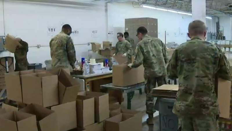Michigan National Guard members help at a food bank in Pontiac, Mich. on March 30, 2020.