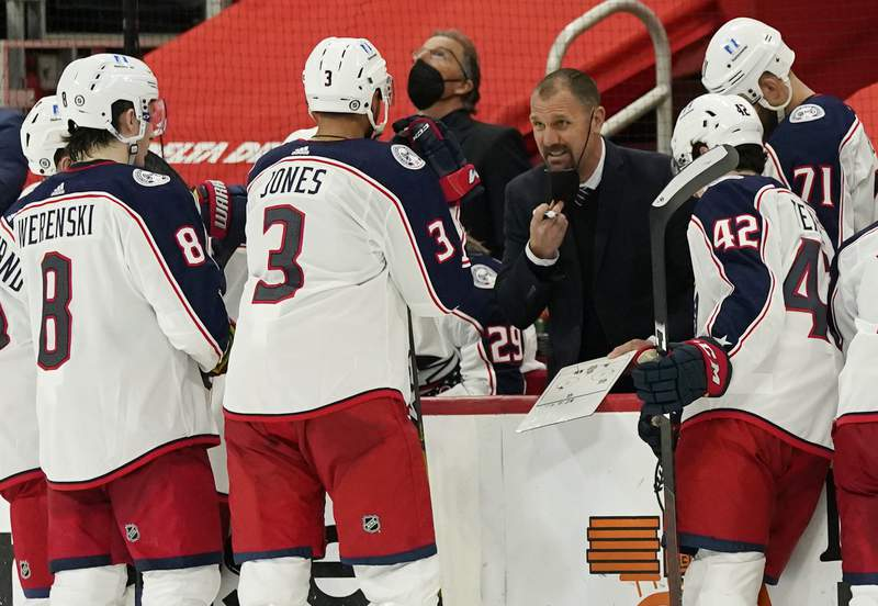 FILE - In this March 27, 2021, file photo, Columbus Blue Jackets assistant coach Brad Larsen talks to the team during the third period of an NHL hockey game against the Detroit Red Wings in Detroit. The Blue Jackets on Thursday, June 10, promoted Larsen to fill the head coaching vacancy left after Columbus parted ways with John Tortorella after six seasons. (AP Photo/Carlos Osorio, File)