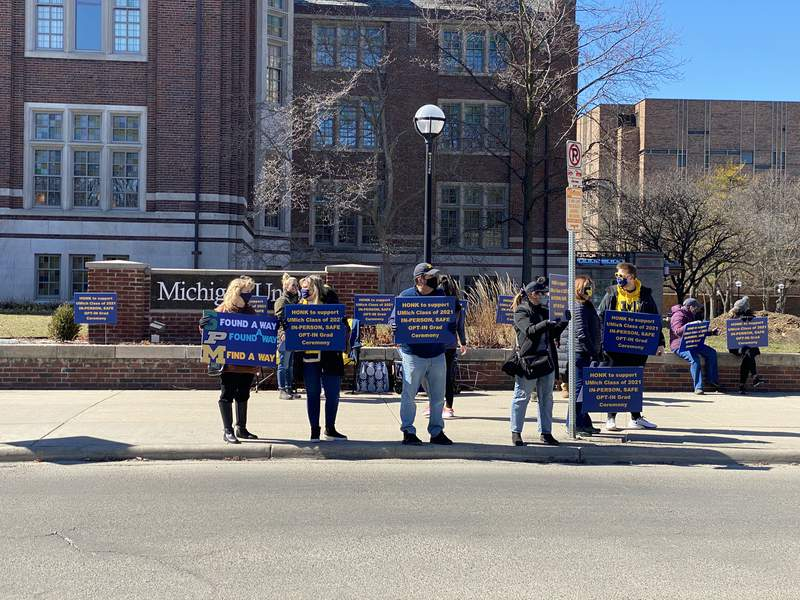 Parents and students rally outside the Michigan Union on March 6, 2021, calling for an in-person Spring Commencement.