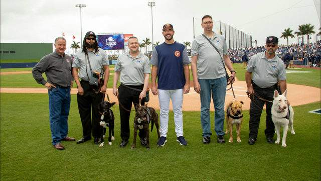 Justin Verlander and Kate Upton presented four military veterans with service dogs on March 20, 2019. (Photo: Maria C. Baker)