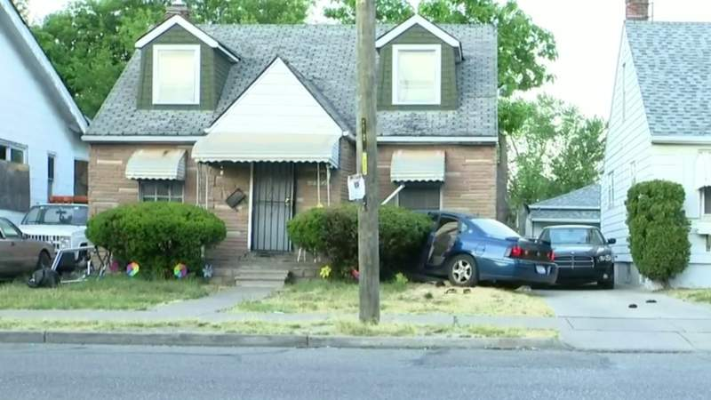 Witness says 2 girls were trapped after car crashed into house on Detroit's east side