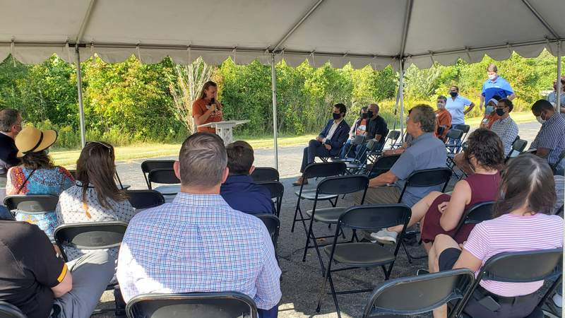 Avalon Housing Executive Director Aubrey Patiño speaks to the crowd about Hickory Way.