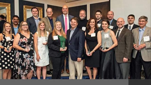 Ann Arbor SPARK president and CEO Paul Krutko (center) with the 2018 FastTrack Award winners (Credit: Ann Arbor SPARK)