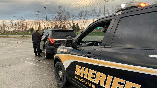 Deputy Michael Dixon of the Macomb County Sheriff's Office makes a traffic stop on April 23.