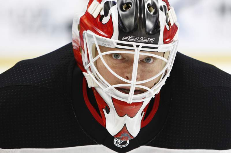 FILE - In this Oct. 9, 2017, file photo, New Jersey Devils goalie Corey Schneider (35) skates prior to the first period of an NHL hockey game against the Buffalo Sabres in Buffalo, N.Y. NHL players are concerned the league will announce a drop-dead deadline for returning to action. New Jersey Devils goaltender Cory Schneider said Monday, May 18, 2020, in a telephone conference call players are asking about a deadline more often in recent weeks as the pause due to the coronavirus pandemic has passed the two-month mark. (AP Photo/Jeffrey T. Barnes, File)