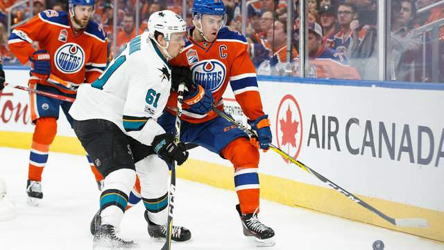 Connor McDavid #97 of the Edmonton Oilers battles against Justin Braun #61 of the San Jose Sharks in Game Five on April 20, 2017 in Edmonton, Alberta, Canada. (Photo by Codie McLachlan/Getty Images)