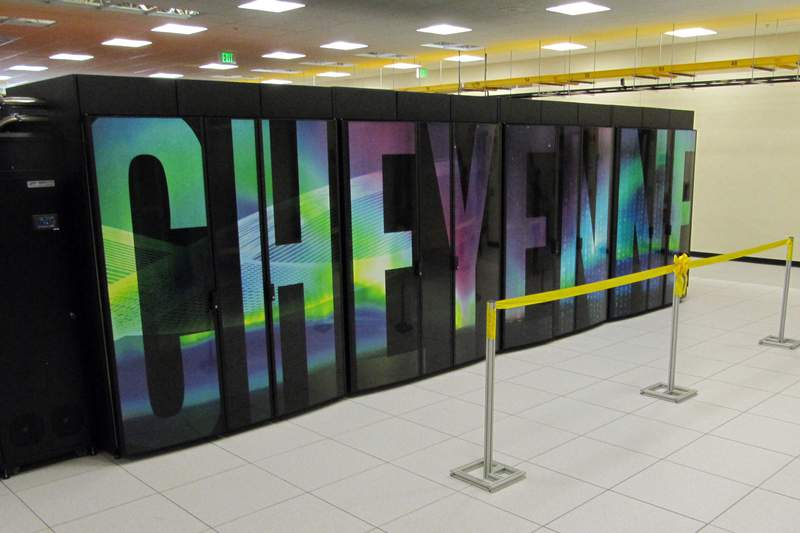 FILE - In this Aug. 8, 2017, file photo, is the current supercomputer named Cheyenne at the NCAR-Wyoming Supercomputing Center near Cheyenne, Wyo. A new supercomputer in Wyoming will rank among the world's fastest and help study phenomena including climate change, severe weather, wildfires and solar flares. Houston-based Hewlett Packard Enterprise won in bidding to provide the $35-$40 million machine for a supercomputing center in Cheyenne, the National Center for Atmospheric Research in Boulder, Colo., announced Wednesday, Jan. 27, 2021. (AP Photo/Mead Gruver, File)