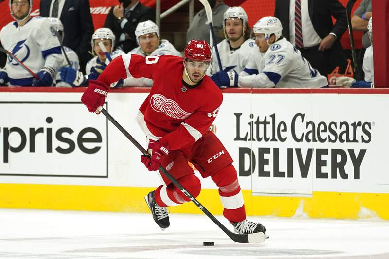 Detroit Red Wings center Joe Veleno (90) plays against the Tampa Bay Lightning in the second period of an NHL hockey game Saturday, May 1, 2021, in Detroit. (AP Photo/Paul Sancya)