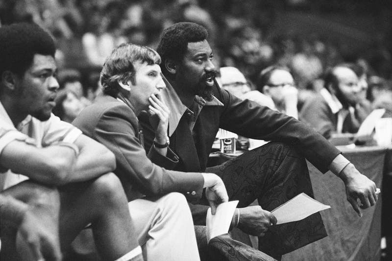 FILE - In this 1974 photo, Wilt Chamberlain, right, coach of the San Diego Conquistadors, and assistant coach Stan Albeck, middle, watch in the opening minutes of the team's basketball game against the New York Nets. Albeck, the former San Antonio, Cleveland, New Jersey and Chicago head coach during a long NBA career, died Thursday, March 25, 2021, in hospice care at son John's home. He was 89. (AP Photo/Richard Drew, File)