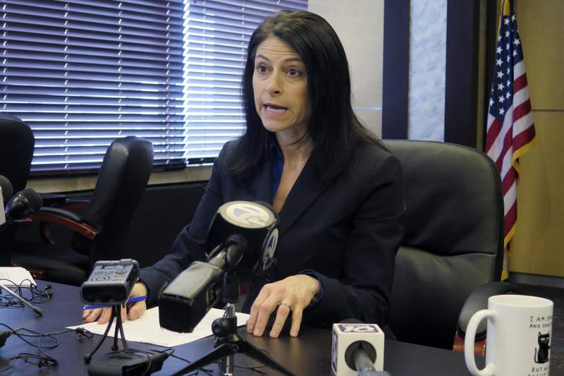 FILE - In this March 5, 2020 file photo, Michigan Attorney General Dana Nessel addresses the media during a news conference, in Lansing, Mich. Nessel on Tuesday, May 5, 2020, is backing Gov. Gretchen Whitmer, telling local law enforcement officials that her stay-at-home directive and restrictions on places of public accommodations are valid and enforceable. Tuesday's letter comes days after Republican lawmakers refused to extend an emergency declaration. (AP Photo/David Eggert, File)