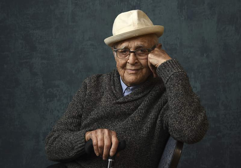 """FILE - Norman Lear, executive producer of the Pop TV series """"One Day at a Time,"""" poses for a portrait during the Winter Television Critics Association Press Tour on Jan. 13, 2020, in Pasadena, Calif.. The Golden Globes will bestow the Carol Burnett Award to Lear during the 78th annual awards ceremony next month. The Hollywood Foreign Press Association announced Thursday, Jan. 28, 2021, that Lear will be honored during the Feb. 28 event. (AP Photo/Chris Pizzello, File)"""