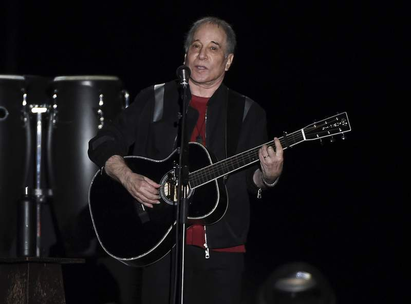 FILE - Paul Simon performs during the final stop of his Homeward Bound - The Farewell Tour concert on Sept. 22, 2018, in New York. Sony Music Publishing announced Wednesday, March. 31, 2021, that it has acquired Simon's catalog, which includes six decades of music, from his time in Simon & Garfunkel to his solo career. Financial details of the deal were not announced. (Photo by Evan Agostini/Invision/AP, File)