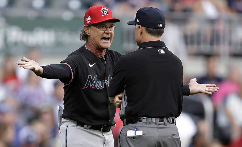 Miami Marlins manager Don Mattingly reacts after being ejected in the first inning of the team's baseball game against the Atlanta Braves on Friday, July 2, 2021, in Atlanta. (AP Photo/Ben Margot)