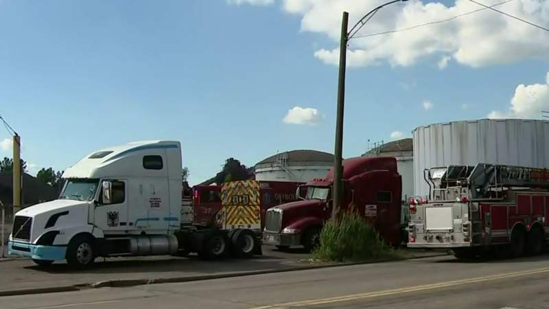 Driver trapped after power lines fall on truck in Detroit
