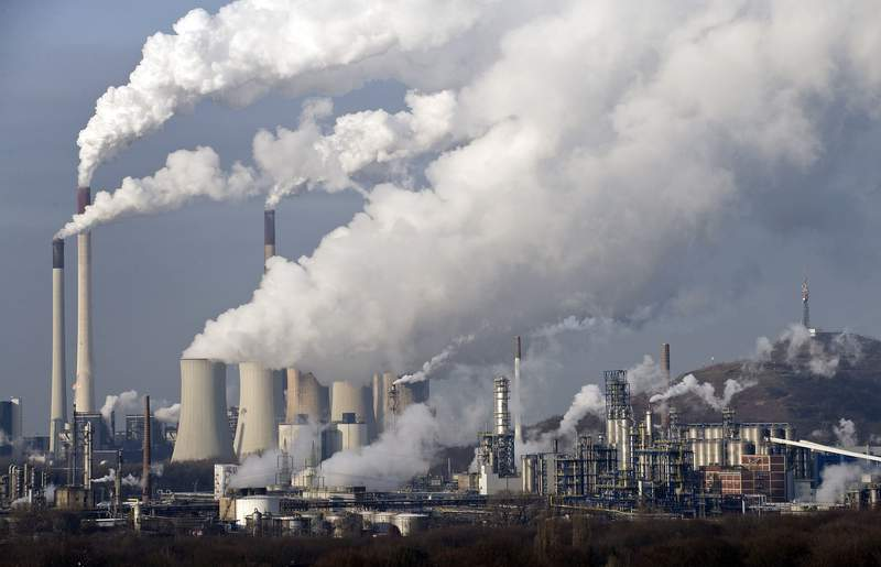 FILE - In this Dec. 16, 2009 file photo, steam and smoke rise from a coal burning power plant in Gelsenkirchen, Germany. The state governors Dietmar Woidke of Brandenburg, Michael Kretschmer of Saxony, Reiner Haseloff of Saxony-Anhalt and Armin Laschet of North Rhine-Westphalia meet in Berlin for the adoption by the Bundestag and Bundesrat of the laws on coal phase-out and structural strengthening in the affected federal states. (AP Photo/Martin Meissner, File)