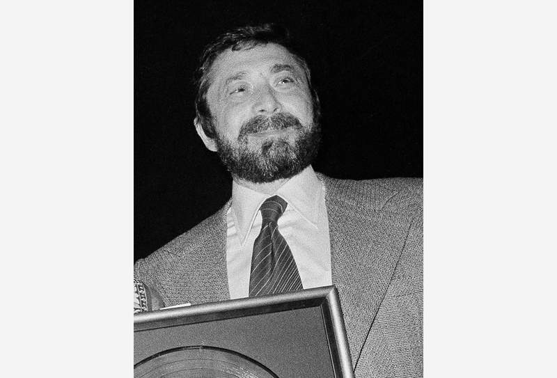 FILE - Walter Yetnikoff, president of CBS Records, presents gold records in New York on Jan. 17, 1978. Yetnikoff, the rampaging, R-rated head of CBS Records who presided over blockbuster releases by Michael Jackson, Billy Joel and many others and otherwise devoted his life to a self-catered feast of schmoozing, shmingling and bingling, has died at age 87.  Yetnikoff's death was confirmed Tuesday, Aug. 10, 2021, by David Ritz, who collaborated with Yetnikoff on his memoir Howling at the Moon.  (AP Photo/Carlos Rene Perez, File)