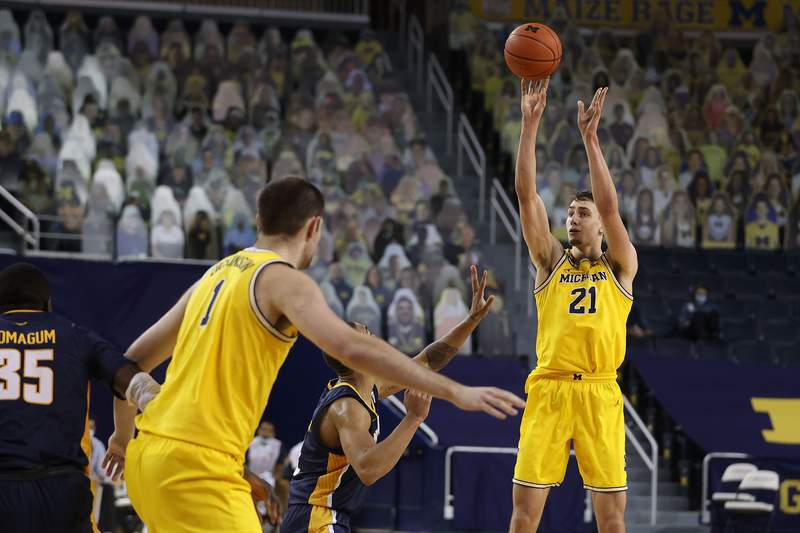 Franz Wagner #21 of the Michigan Wolverines takes a second half shot against the Toledo Rockets at Crisler Arena on December 09, 2020 in Ann Arbor, Michigan.