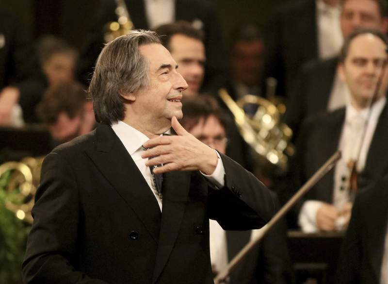 FILE - In this Jan. 1, 2018 file photo, Italian Maestro Riccardo Muti conducts the Vienna Philharmonic Orchestra during the traditional New Year's concert at the golden hall of Vienna's Musikverein, Austria. Riccardo Muti will conduct a youth orchestra in an open-air concert launching the annual Ravenna Festival next month in what organizers billed Friday May 22, 2020, as Italys first live classical music performance since its strict lockdown to stop the spread of coronavirus. (AP Photo/Ronald Zak, File)