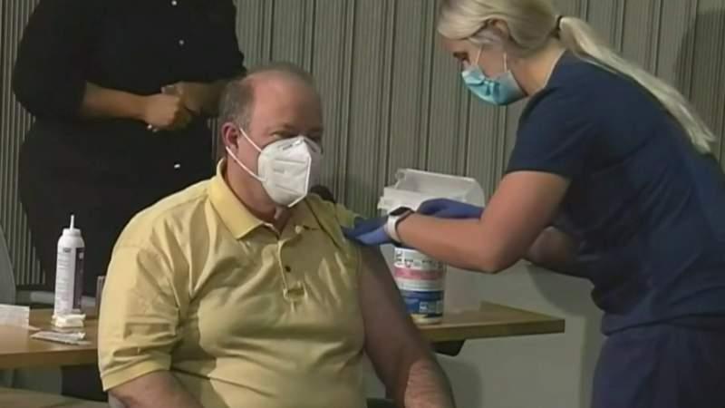 Detroit Mayor Mike Duggan receives a shot of COVID-19 vaccine.