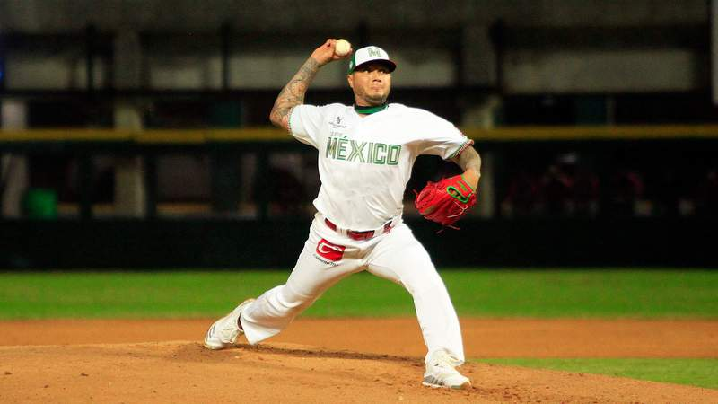 Hector Velazquez of Mexico throws the ball in the first inning during a game between Dominican Republic and Mexico as part of Serie del Caribe 2021.
