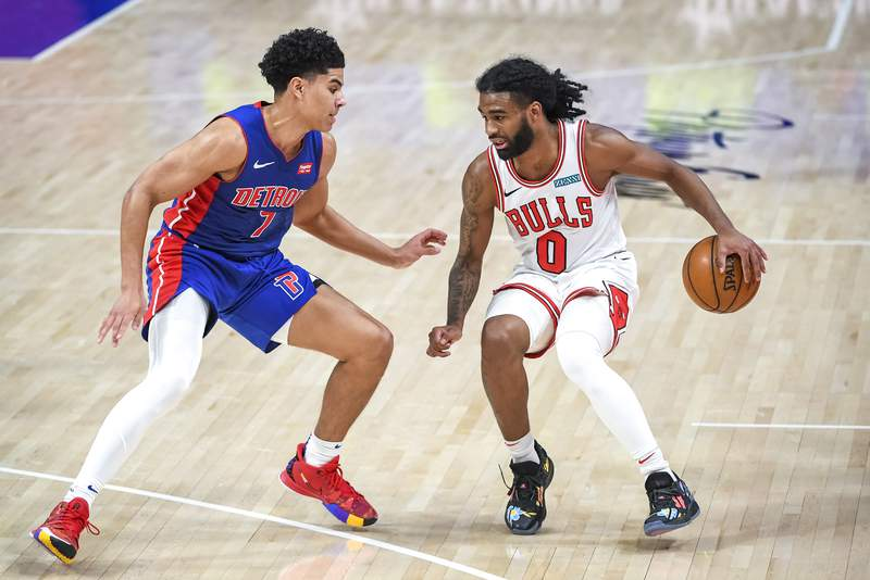 DETROIT, MICHIGAN - MAY 09: Killian Hayes #7 of the Detroit Pistons defends Coby White #0 of the Chicago Bulls during the third quarter of the NBA game at Little Caesars Arena on May 09, 2021 in Detroit, Michigan. NOTE TO USER: User expressly acknowledges and agrees that, by downloading and or using this photograph, User is consenting to the terms and conditions of the Getty Images License Agreement. (Photo by Nic Antaya/Getty Images)