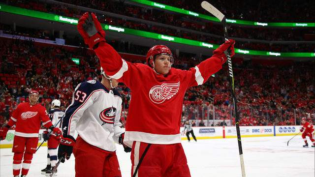 Dennis Cholowski celebrates his first NHL goal in the first period while playing the Columbus Blue Jackets at Little Caesars Arena on October 4, 2018 in Detroit. (Photo by Gregory Shamus/Getty Images)