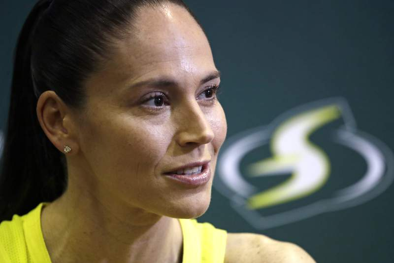 FILE - In this Monday, May 13, 2019, file photo, Seattle Storm's Sue Bird talks with media members at the basketball team's media day in Seattle. Groups that advocate for civil rights and womens rights have joined notable athletes in asking the NCAA to move the first and second rounds of the 2021 mens basketball tournament out of Idaho after the state passed a law banning transgender women from competing in womens sports. A letter sent and signed by a list of professional athletes including Megan Rapinoe, Billie Jean King, Jason Collins and Sue Bird calls for the NCAA to move the games set to be held March 2021 at Boise State University. (AP Photo/Elaine Thompson, File)