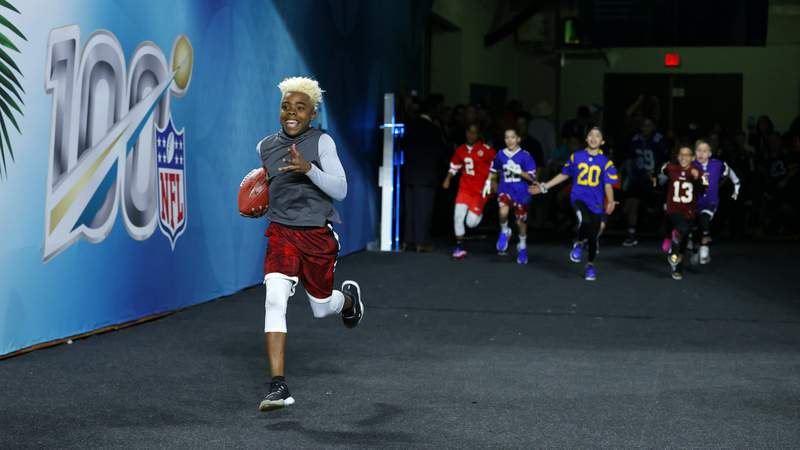 """Maxwell """"Bunchie"""" Young runs on the field prior to Super Bowl LIV. (Photo by Kevin C. Cox/Getty Images)"""