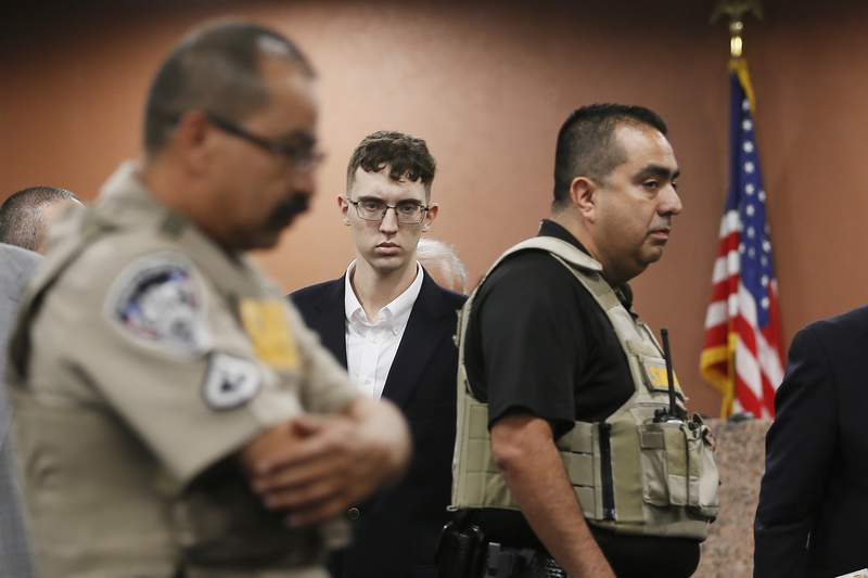 FILE - In the is Oct. 10, 2019 file photo, El Paso Walmart shooting suspect Patrick Crusius pleads not guilty during his arraignment in El Paso, Texas. The government has filed hate crime charges against Crusius, who said he was targeting Mexicans and shot to death 22 people at a Walmart store in El Paso, Texas, last summer, a person familiar with the matter told The Associated Press. (Briana Sanchez / El Paso Times via AP, Pool, File)