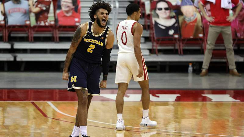 Isaiah Livers #2 of the Michigan Wolverines reacts to a three point shot during the second half against the Wisconsin Badgers at Kohl Center on February 14, 2021 in Madison, Wisconsin.