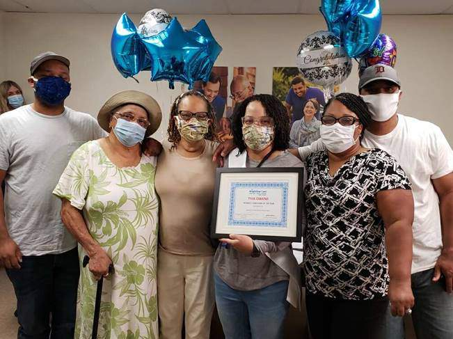 Tyja Owens (holding her BrightStar Care Midwest Caregiver of The Year Award) and her family at a small celebration held on Aug. 20.
