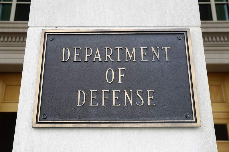 FILE - This April 19, 2019 file photo shows a sign for the Department of Defense at the Pentagon in Washington. The Biden administrations nominee for top Pentagon policy adviser was met with sharp criticism from Republicans on the Senate Armed Services Committee Thursday, including accusations that he has been too partisan to be confirmed for the job. Colin Kahl, who served as national security adviser to then-Vice President Joe Biden during the Obama administration, faced repeated questions on his previous support for the Iran nuclear deal and how he would approach that issue now. (AP Photo/Patrick Semansky)