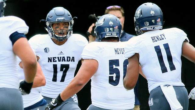 Brendan O'Leary-Orange #17 of the Nevada Wolf Pack is congratulated by teammates Kalei Meyer #56 and Daiyan Henley #11 after scoring a touchdown against the Vanderbilt Commodores during the first half at Vanderbilt Stadium on September 8, 2018 in Nashville, Tennessee. (Photo by Frederick Breedon/Getty Images)