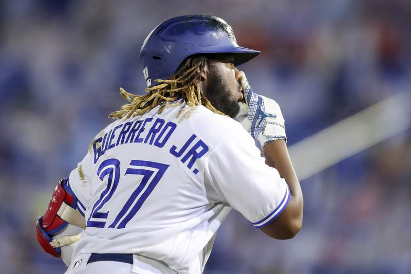 Toronto Blue Jays' Vladimir Guerrero Jr. gestures rounding third base after hitting his third home run against the Washington Nationals during the seventh inning of a baseball game Thursday, April 27, 2021, in Dunedin, Fla. (AP Photo/Mike Carlson)