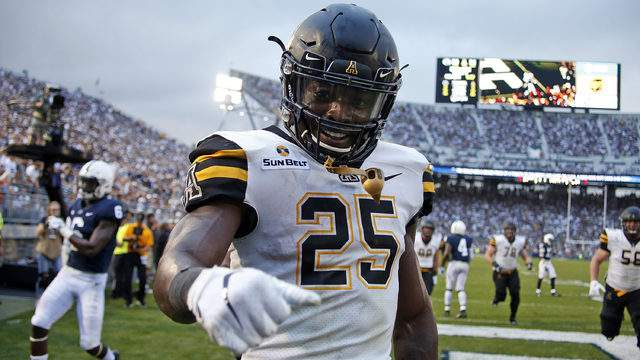 Jalin Moore #25 of the Appalachian State Mountaineers celebrates after rushing for a 16 yard touchdown in the fourth quarter against the Penn State Nittany Lions on September 1, 2018 at Beaver Stadium in State College, Pennsylvania. (Photo by Justin K. Aller/Getty Images)