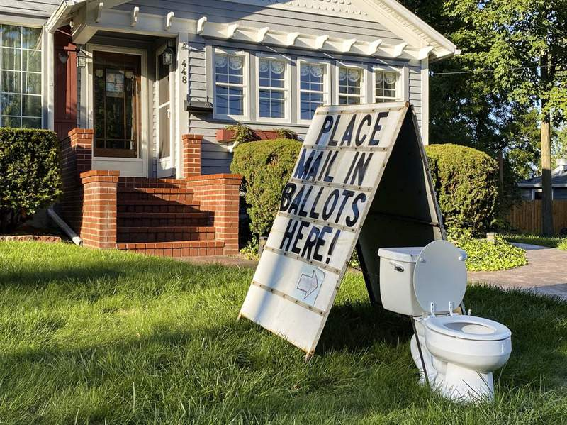 A political display is set up in the lawn of a home on West Columbia Street in Mason, Mich., on Friday, Sept. 18, 2020. Barb Byrum, the Democratic clerk of Ingham County, filed a complaint with police over the display, saying it could mislead people who aren't familiar with how mail-in voting works. (Matthew Dae Smith/Lansing State Journal via AP)