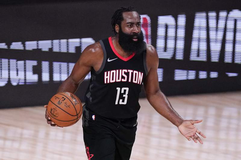 FILE - In this Sept. 12, 2020, file photo, Houston Rockets' James Harden (13) argues a call during the first half of an NBA conference semifinal playoff basketball game against the Los Angeles Lakers in Lake Buena Vista, Fla. Harden has not reported to training camp with the Rockets and coach Stephen Silas says he did not know when the All-Star guard would arrive. The Rockets had their second workout of training camp on Monday, Dec. 7, 2020, and afterward the new coach addressed the absence of the disgruntled star who reportedly wants to be traded. (AP Photo/Mark J. Terrill, File)