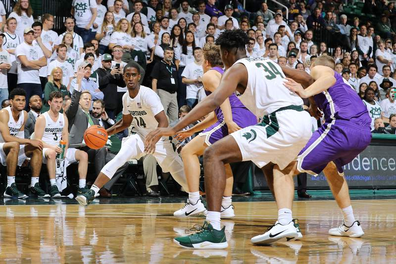 EAST LANSING, MI - OCTOBER 29: Brock Washington #14 of the Michigan State Spartans attempts to pass the ball to Julius Marble #34 of the Michigan State Spartans during an exhibition game against the Albion Britions at Breslin Center on October 29, 2019 in East Lansing, Michigan. (Photo by Rey Del Rio/Getty Images)