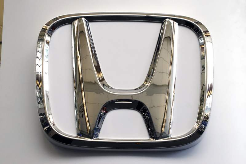 FILE- This Feb. 14, 2019 file photo shows a Honda logo at the 2019 Pittsburgh International Auto Show in Pittsburgh. Honda has plans to sell two all-electric SUVs in the U.S. for the 2024 model year, and it soon will offer hybrid gas-electric versions of its top-selling models. The announcements Thursday, March 11, 2021 come as the automaker acknowledges it has work to do to comply with emissions-reduction targets that will be coming from the Biden administration, and a California ban on sales of new internal-combustion vehicles by 2035. (AP Photo/Gene J. Puskar, File)