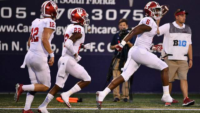 Peyton Ramsey #12, Whop Philyor #22, and Donavan Hale #6 of the Indiana Hoosiers celebrate a touchdown during the first half against the FIU Golden Panthers at Ricardo Silva Stadium on September 1, 2018 in Miami, Florida. (Photo by Mark Brown/Getty Images)