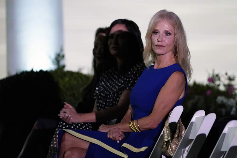 Kellyanne Conway waits for first lady Melania Trump to arrive to speak to the 2020 Republican National Convention from the Rose Garden of the White House, Tuesday, Aug. 25, 2020, in Washington. (AP Photo/Evan Vucci)