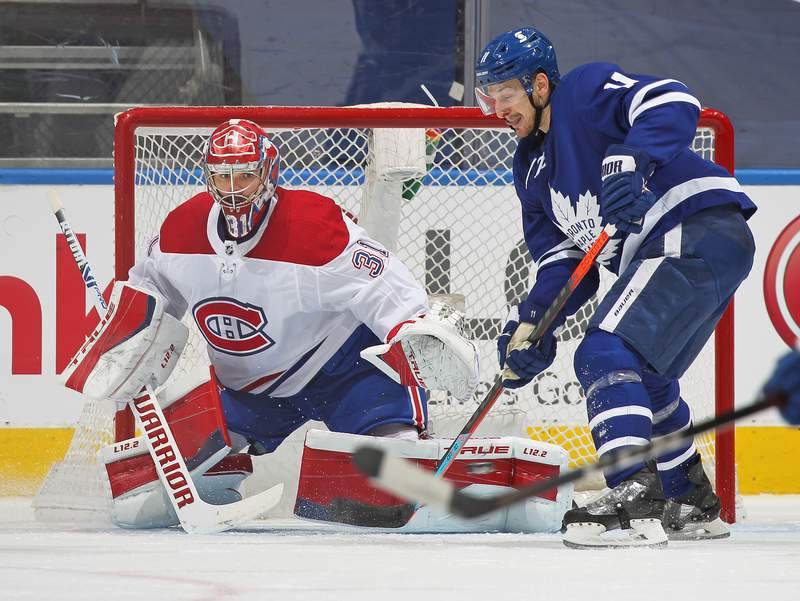 TORONTO, ON - MAY 31:  Carey Price #31 of the Montreal Canadiens watches the puck about to be tipped by Zach Hyman #11 of the Toronto Maple Leafs during Game Seven of the First Round of the 2021 Stanley Cup Playoffs at Scotiabank Arena on May 31, 2021 in Toronto, Ontario, Canada. The Canadiens defeated the Map[le Leafs 3-1 to win series 4 games to 3. (Photo by Claus Andersen/Getty Images)