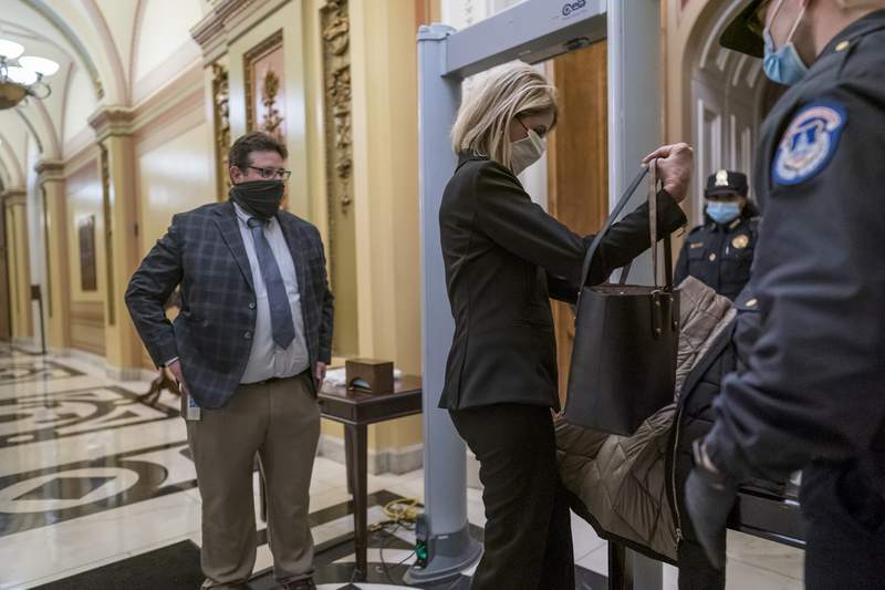 Metal detectors are set up for lawmakers and staff before entering the House chamber, a new security measure put into place after a mob loyal to President Donald Trump stormed the Capitol, in Washington, Tuesday, Jan. 12, 2021. The House is trying to push the vice president and Cabinet to act even more quickly to remove President Donald Trump from office. Democrats are set to pass a resolution calling on Vice President Mike Pence to invoke constitutional authority under the 25th Amendment to oust Trump. (AP Photo/J. Scott Applewhite)