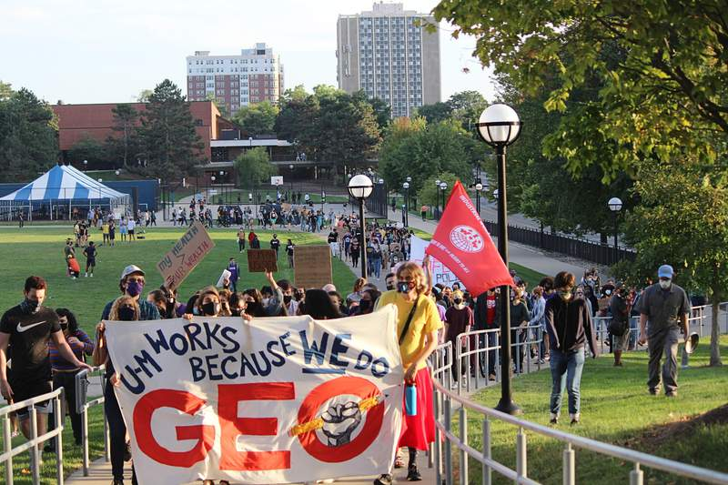 Members of GEO and other University of Michigan students protested and marched in Ann Arbor, Michigan on Friday, Sept. 11.