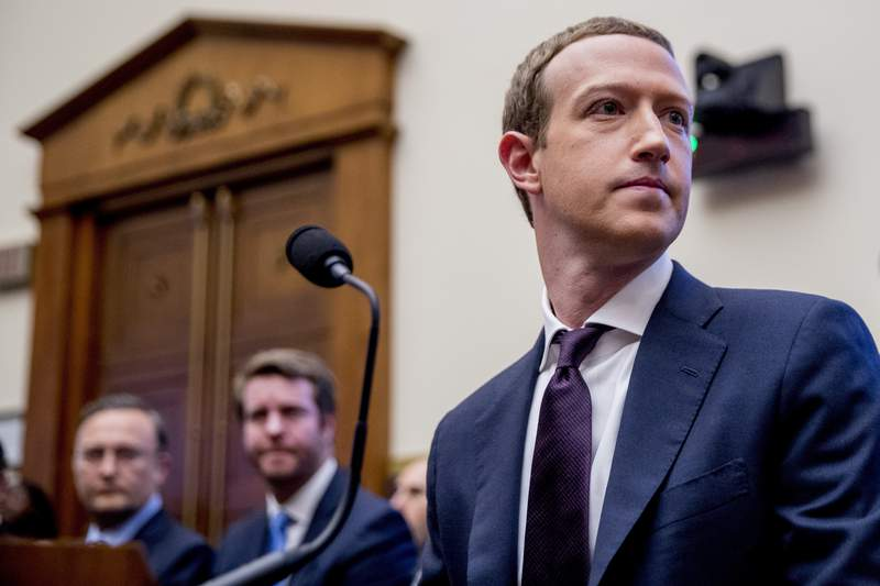 FILE - In this Wednesday, Oct. 23, 2019, file photo, Facebook CEO Mark Zuckerberg arrives for a House Financial Services Committee hearing on Capitol Hill in Washington, on Facebook's impact on the financial services and housing sectors. Ever since Russian agents and other opportunists abused its platform in an attempt to manipulate the 2016 U.S. presidential election, Facebook has insisted, repeatedly, that its learned its lesson and is no longer a conduit for misinformation, voter suppression and election disruption. (AP Photo/Andrew Harnik, File)