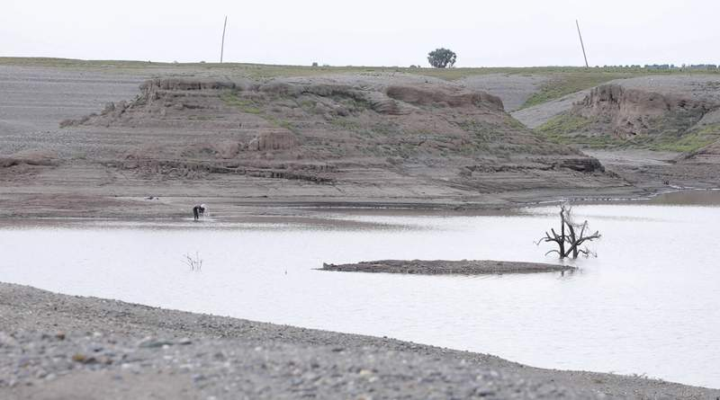 In this photo taken from a video shot on Wednesday, Aug. 4, 2021 in Wad el-Hilu, Sudan, a man washes in the Setit river, known in Ethiopia as Tekeze River. Locals and refugees have pulled dozens from bodies from the river separating Ethiopias troubled Tigray region from Sudan in the past week, many with bullet wounds and their hands bound. Witnesses say that they are ethnic killings committed by Ethiopian government forces of Tigrayans, and that the bodies are being dumped to conceal the evidence. There was no immediate comment from the Ethiopian government but it has denied ethnic killings in the past.  (AP Photo/Mohaned Awad)