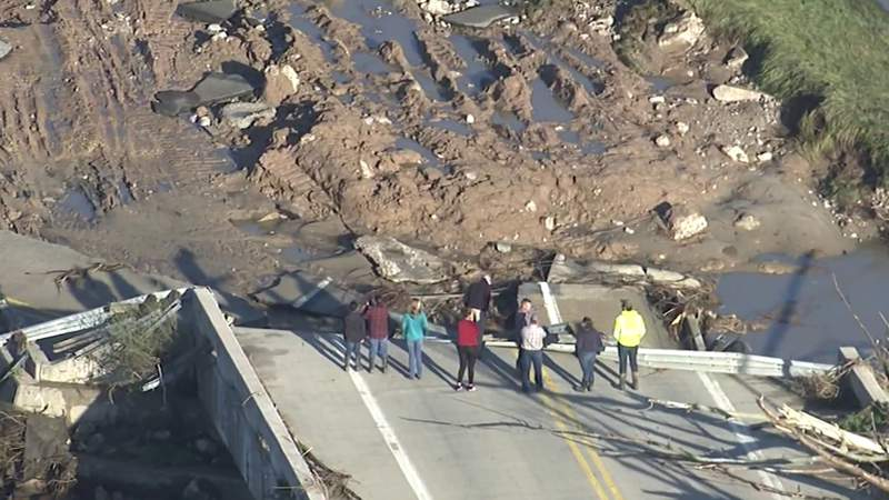 People gathering at the end of a road that was cut off by floodwater in Midland County on May 20, 2020.